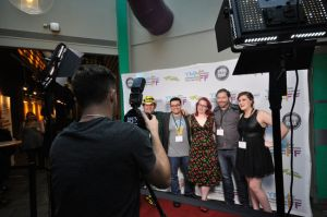Photographer Rick Falls, front, takes a photo on the red carpet of the Fort McMurray International Film Festival in Fort McMurray Alta. on September 5, 2015. Back, left to right: Todd Hillier, Tito Guillen, Theresa Wells, Steve Reeve, Ashley Laurenson. Garrett Barry/Fort McMurray Todayé Postmedia Network
